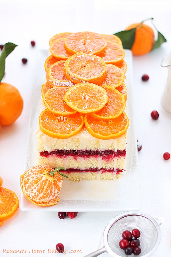 Citrus cranberry layer cake - a light and refreshing citrus cake sandwiched with tart cranberry sauce for an explosion of flavors and textures. Recipe from Roxanashomebaking.com