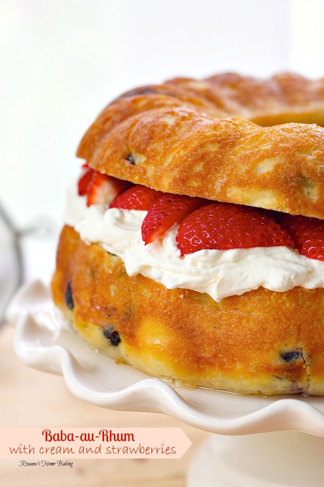 Baba au Rhum from Roxanashomebaking.com A bundt no knead rich yeast coffee cake with dried fruit, soaked in rum syrup and filled with whipped cream and fresh strawberries