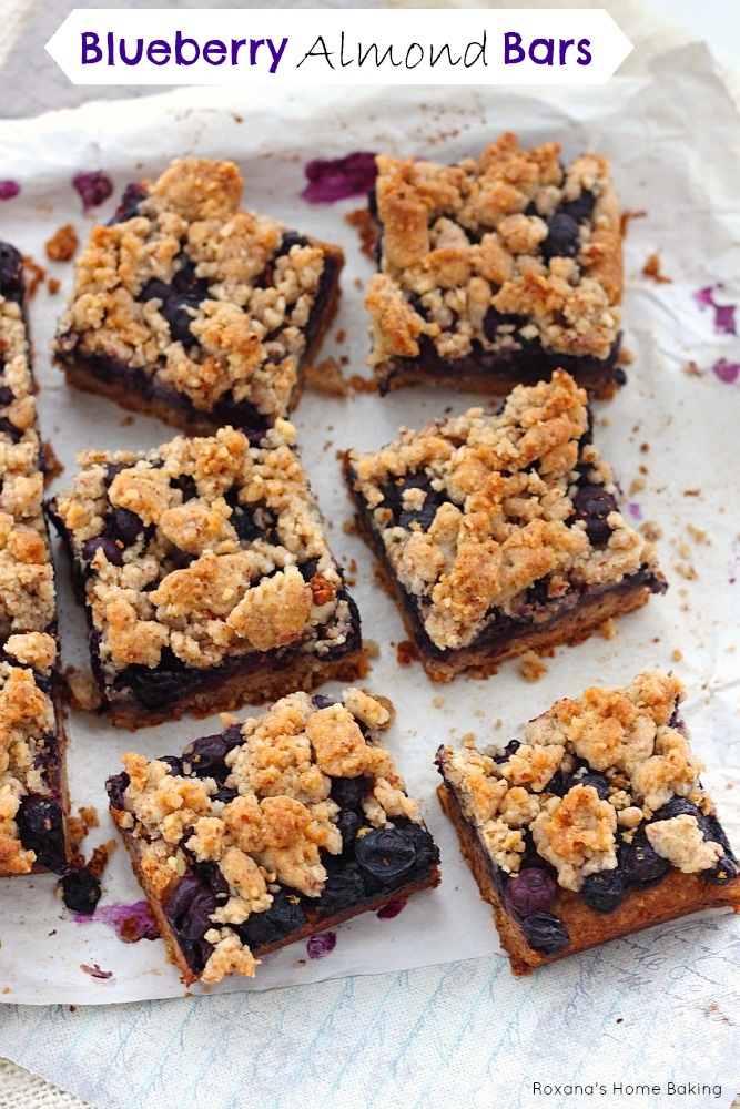 Blueberry almond bars from Roxanashomebaking.com  Buttery cookie almond base topped with a layer of sweet and juicy blueberries and crumbled topping. A great way to enjoy both fruit and nuts in one bite.