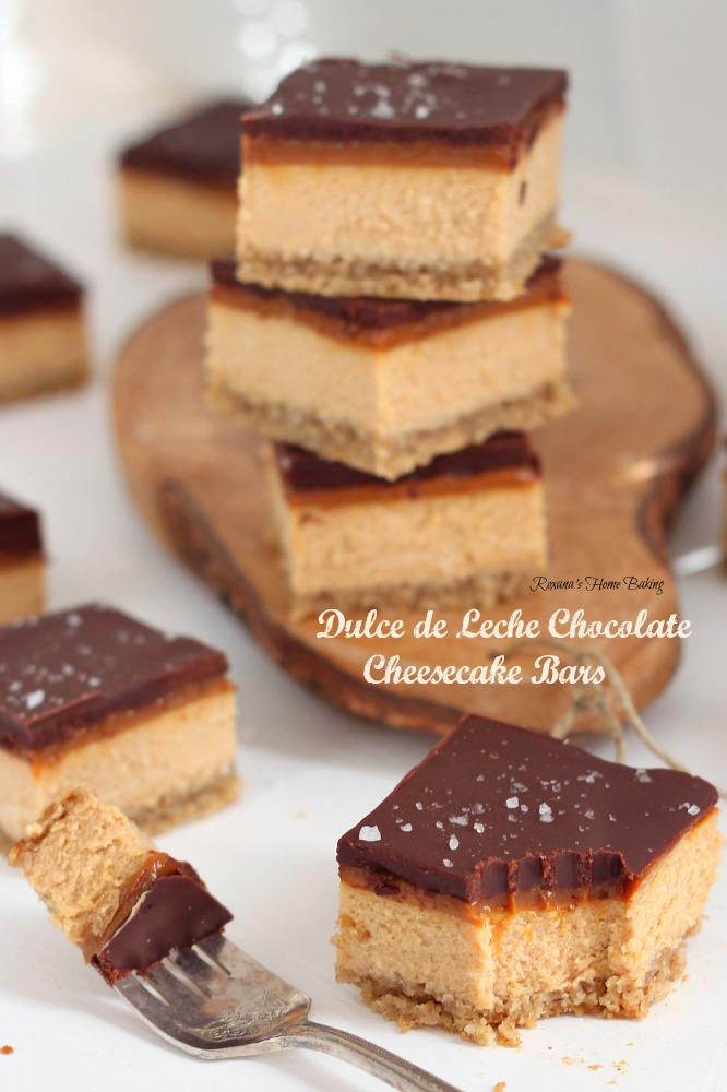 Dulce de leche chocolate cheesecake bars from Roxanashomebaking.com Rich creamy caramel-y cheesecake topped with a thin layer of dulce de leche and chocolate ganache and a sprinkle of fleur de sel.
