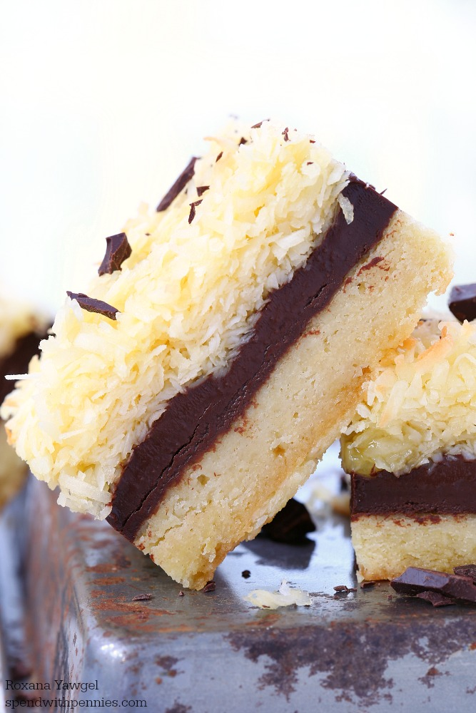 No mixer needed to make these chocolate fudge ripple coconut bars! Buttery cookie layer topped with chocolate fudge & coconut make these bars irresistible!