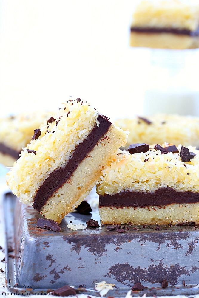 Chocolate fudge ripple coconut bars! Layers of buttery cookie crust topped with rich chocolate fudge and lots of coconut make these bars absolutely irresistible!